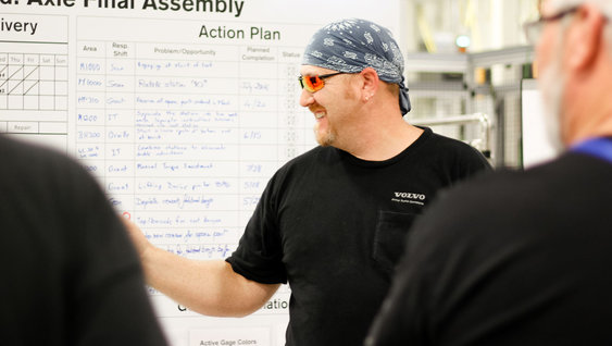 Man in glasses pointing on a whiteboard