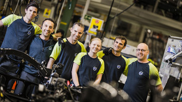 Six Volvo Group production workers in a Volvo factory