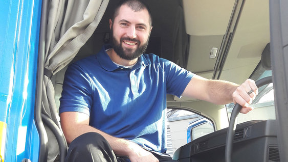 Individual sitting in a Volvo truck cab
