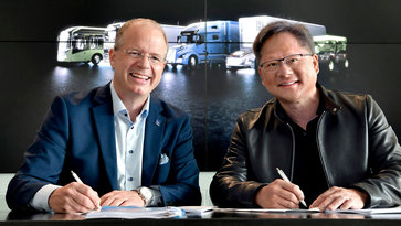 Martin Lundstedt, President & CEO Volvo Group, and Jensen Huang, NVIDIA founder and CEO, signing a partnership contract