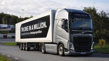 "Grey Volvo truck with the message ""I'm one in a million"" on its payload on a road in Gothenburg, Sweden"