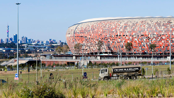 UD Truck on a road in front of the Soccer city stadium in Johannesburg, South Africa