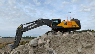 Volvo excavator digging at construction site in Eskilstuna, Sweden