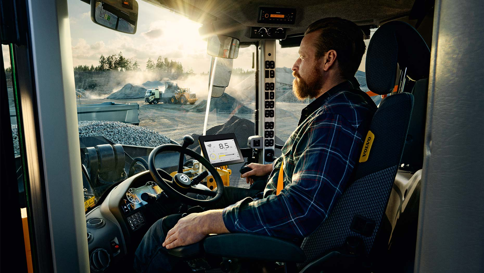 Man driving a Volvo CE product
