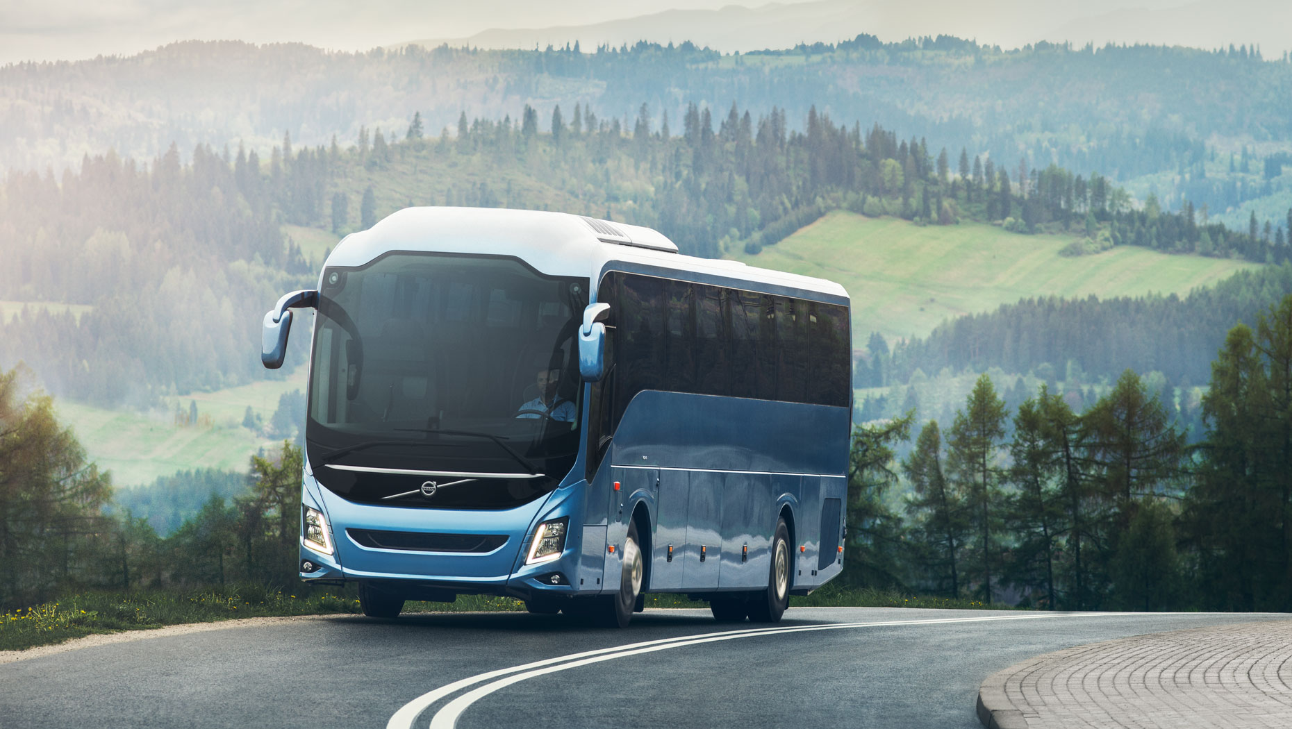 Volvo bus driving on the road