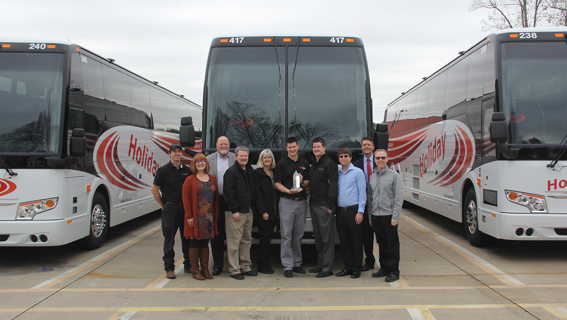 Holiday Tours Celebrates Purchase