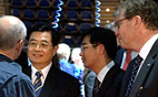 image text: China's President Hu Jintao together with Leif Johansson, President and CEO Volvo Group