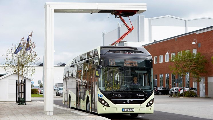 Electric hybrid bus getting charged