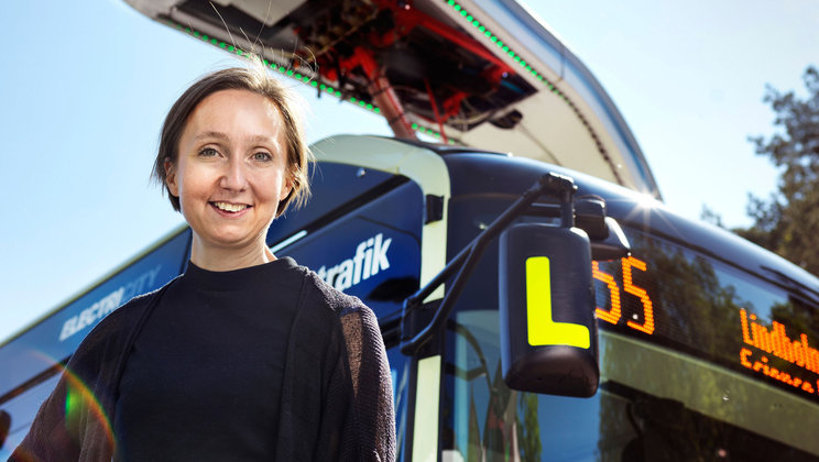 Hanna takes the electric bus to work every day