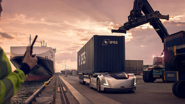 Vera the autonomous vehicle from Volvo Group at a harbour carrying a container